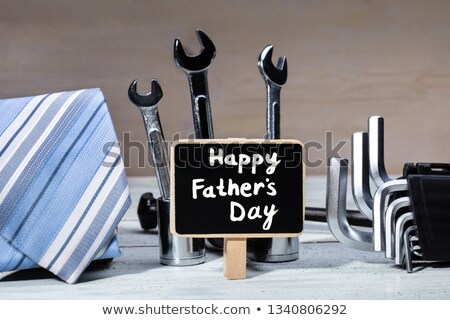 Slate With Text Surrounded With Tools And Tie On Table Stock photo © AndreyPopov