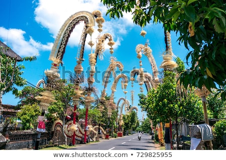 Stock photo: Traditional Bali Penjor - bamboo pole with decoration on village street Indonesian art and culture.