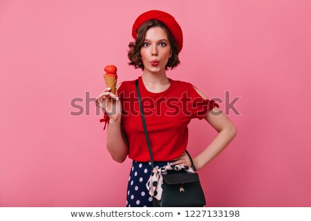 Gorgeous brunette woman in red blouse and white short. stock photo © studiolucky