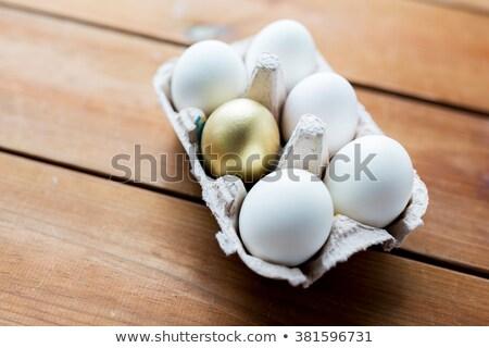 Hat arany tojások tojás karton gyűjtemény Stock fotó © albund