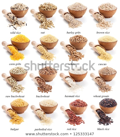 Unpolished rice in a wooden scoop on white background stock photo © Melnyk