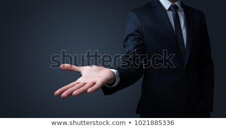 businessman handing something without concept stock photo © ra2studio