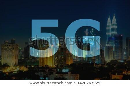 5G text on Kuala Lumpur Malaysia background. Stock photo © szefei