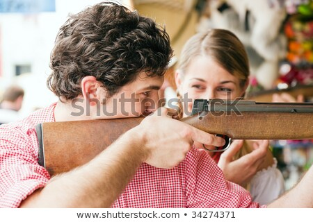 Couple on Bavarian fair at the shooting gallery Stock photo © Kzenon
