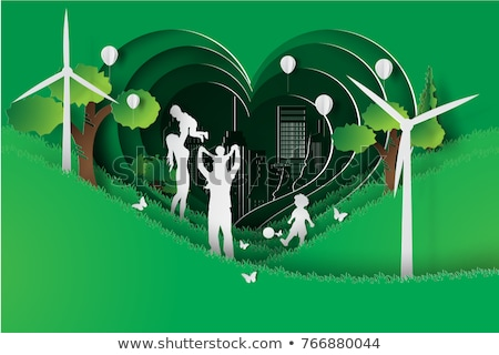 Happy people in green eco city park with windmill Stock photo © cienpies