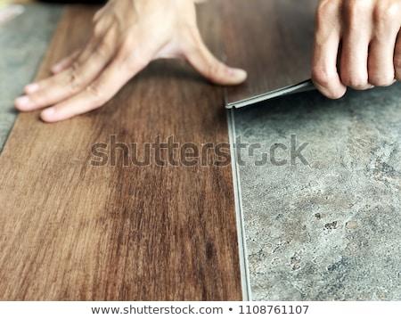 Mann Verlegung Bodenbelag home Gebäude Arbeit Stock foto © Elnur