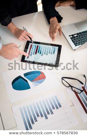 Business analysts are working on tablet and computer with graphs data Stock photo © sgursozlu
