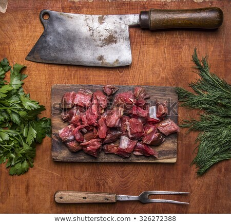 Vintage meat cleaver and fresh herbs Stock photo © Digifoodstock
