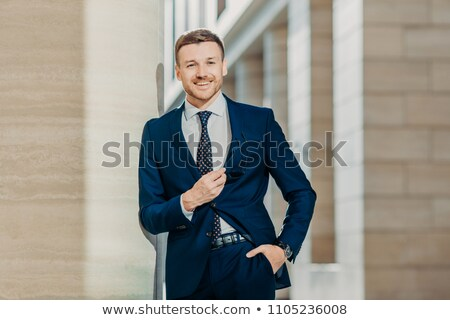 Waist up portrait of successful male lawyer comes on meeting with client, wears elegant formal cloth Stock photo © vkstudio