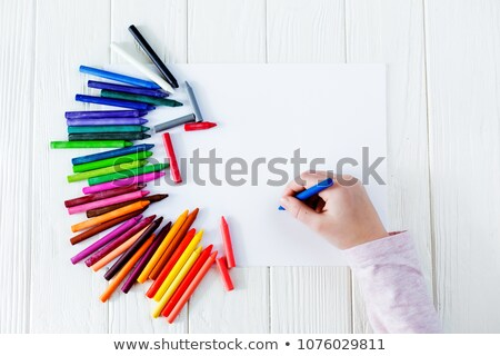 hand holding color crayon paint paper Stock photo © yupiramos