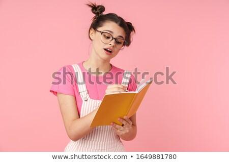 Photo sérieux charmant fille lunettes écrit Photo stock © deandrobot
