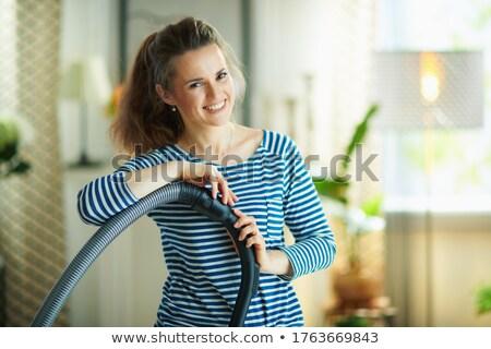 Jonge vrouw stofzuiger witte werk home werknemer Stockfoto © Elnur