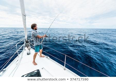 Barbudo pescador vara de pesca lazer pessoas homem Foto stock © dolgachov
