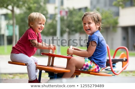 three children on playground stock photo © goce