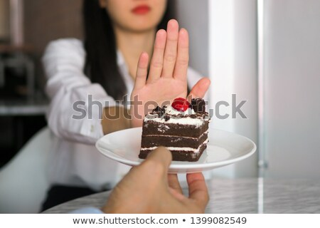Hand refuses cake Stock photo © Hofmeester