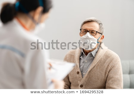 Doctor and senior man. Stock photo © Kurhan