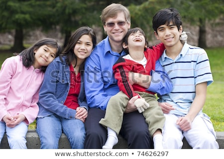 Four year old boy disabled with cerebral palsy sitting outdoors  Stock photo © jarenwicklund