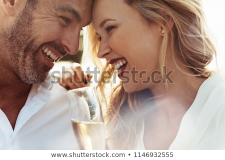 Stock photo: couple looking at a glass of wine