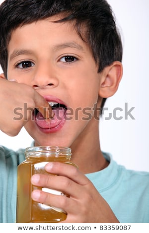 Boy tasting some honey Stock photo © photography33