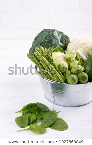 Asparagus sprouts and broccoli floret  Stock photo © zhekos