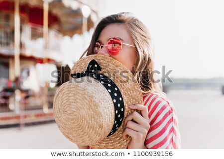 Relaxed woman smiling in the park on a summer's day Stock photo © photography33