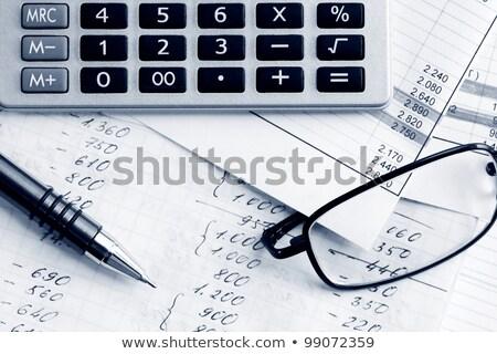 Balancing the Accounts. Calculator, glasses Stock photo © REDPIXEL