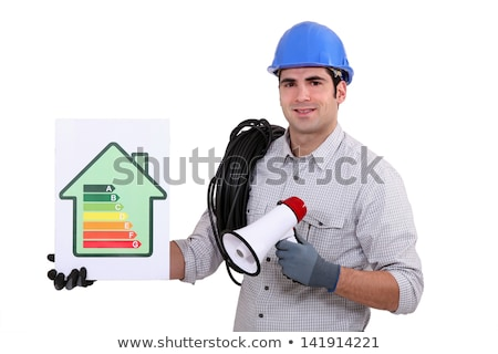 Tradesman holding a megaphone and an energy efficiency rating chart Stock photo © photography33