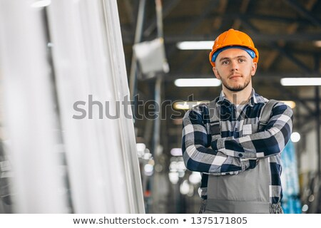 young construction worker thinking stock photo © stevanovicigor