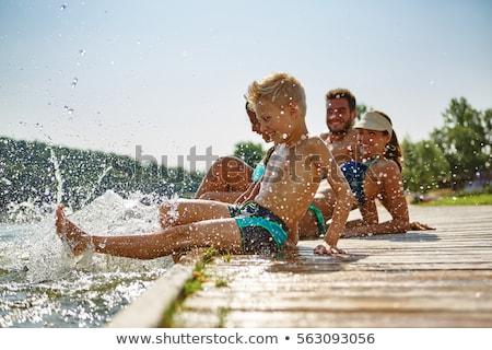 Stock foto: Sommer · Familie · lächelnd · Verlegung · Strand · Kinder