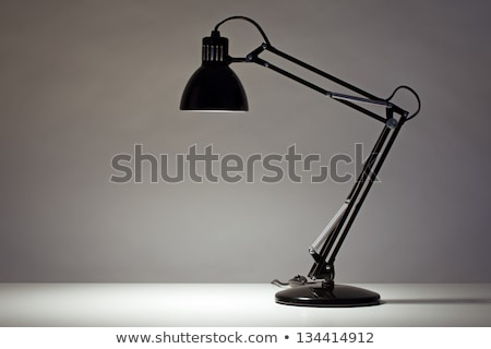 desk lamp and vintage book stock photo © hectorsnchz