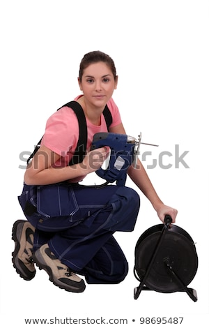 handywoman holding a jigsaw stock photo © photography33