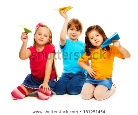 Portrait of girl holding paper plane Stock photo © zzve