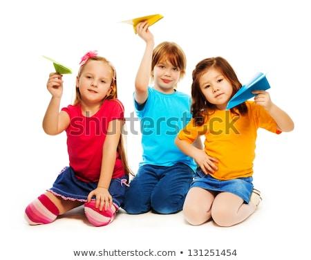 Portré lány tart papír repülőgép boldog Stock fotó © zzve