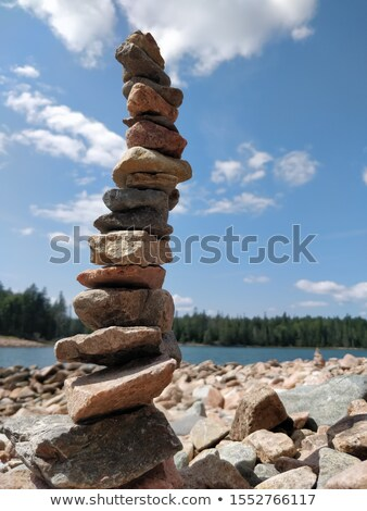 Stack of spa rocks on wood against blue sky Stock photo © Sandralise