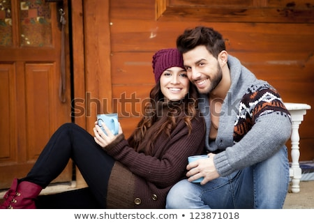 Stock photo: Young happy couple in winter mountains