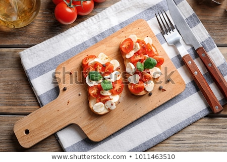 fresh tasty italian bruschetta with tomato on table stock photo © juniart