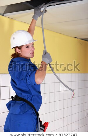 young female electrician pulling wife from weiling stock photo © photography33