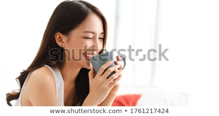 woman holding a hot beverage stock photo © melpomene