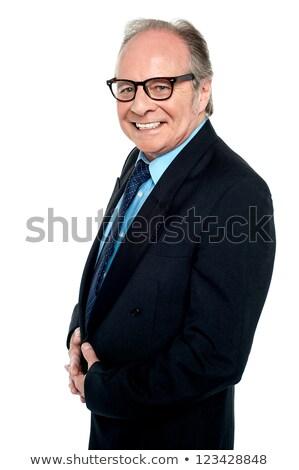 Bespectacled businessman posing sideways stock photo © stockyimages