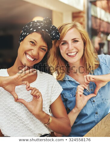 Beautiful vivacious woman with a lovely smile Stock photo © stockyimages