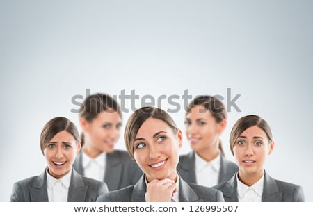 Group of business women clones with different emotions Stock photo © HASLOO