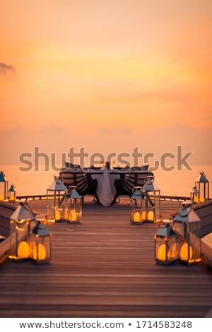 Table for two on a wooden deck Stock photo © jrstock