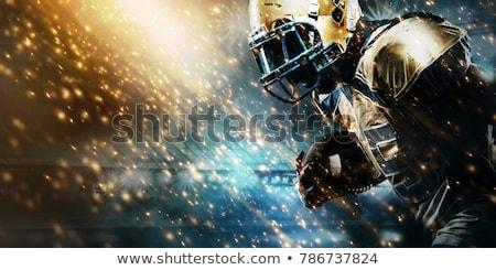 Sérieux joueur visage casque noir Photo stock © pressmaster