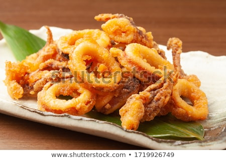 Fresh fried calamari Stock photo © badmanproduction