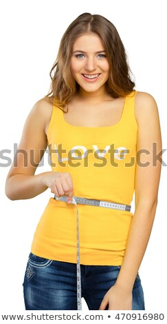Loosing weight - young woman is measuring her waist Stock photo © Kzenon
