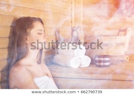 Woman in steam sauna Stock photo © Kzenon