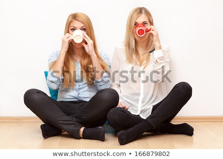 Young beautiful blond woman having tea-party. Stock photo © hasloo