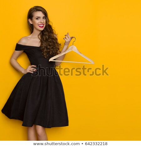 Stock photo: young fashion woman holds hands on hips