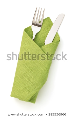 fork knife and white plate on green cloth isolated on white stock photo © tetkoren