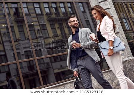 Elegante blijde paar lopen samen jonge Stockfoto © konradbak